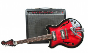 black and red guitar next to  amplifier